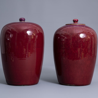 Two Chinese monochrome sang de boeuf glazed jars and covers, 19th C.