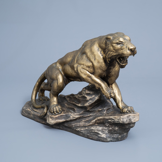 Armand Fagotto (19th/20th C.): A panther on a rock, patinated and gilt terracotta, second quarter of the 20th C.