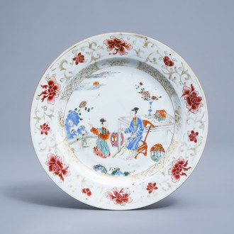 A Chinese famille rose and gilt plate with ladies on a terrace, Yongzheng