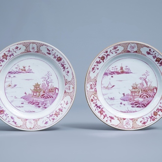 A pair of Chinese puce enamelled and gilt plates with a landscape and floral design, Qianlong