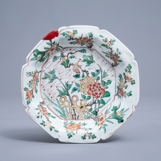 A lobed Chinese famille verte plate with a bird among blossoming branches, Kangxi