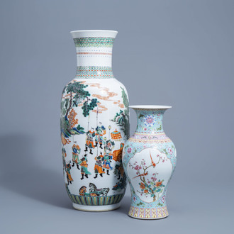 A large Chinese famille verte vase with figurative design all around and a famille rose baluster vase with birds on blossoming branches, 20th C.