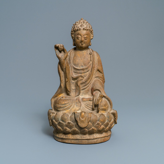 A Chinese sandstone figure of Buddha with traces of polychrome and gilt decoration, Qing