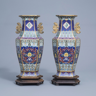 A pair of Chinese hexagonal cloisonné vases with dragons and floral design, Xuande mark, 19th/20th C.