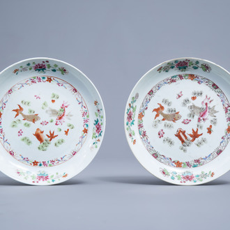 A pair of Chinese famille rose plates with fish and floral design, Qianlong