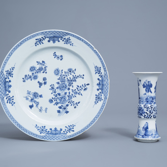 A Chinese blue and white charger with floral design and a gu 'Immortals' vase, Kangxi mark, 18th/19th C.