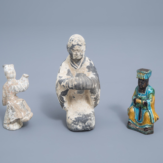 Two Chinese grey Han pottery figures and one sancai glazed figure of a dignitary, Ming
