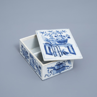 A rectangular Chinese blue and white box and cover with antiquities, 19th C.