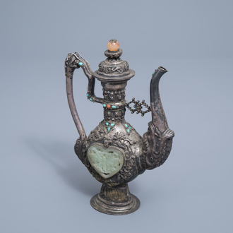 A coral, jade and turquoise inlaid silver ewer and cover, Tibet, 19th/20th C.
