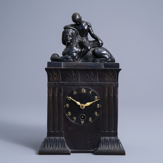 A rare German gilt and patinated bronze Lenzkirch Egyptian revival mantel clock, first quarter of the 20th C.