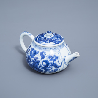 A Chinese blue and white teapot and cover with floral design, Kangxi