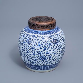 A Chinese blue and white 'lotus scroll' jar with wooden cover, Qianlong