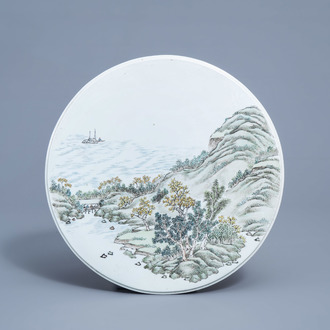 A round Chinese qianjiang cai plaque with a river landscape, 20th C.