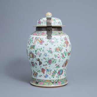 A large Chinese Canton famille rose vase and cover with antiquities, 19th C.