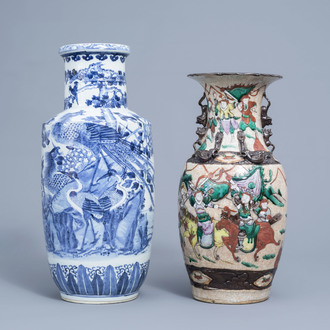 A Chinese blue and white rouleau vase with birds among blossoming branches and a famille rose Nanking crackle glazed 'warriors' vase, 19th C.