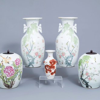 Four Chinese famille rose vases and jars and covers with birds among blossoming branches and an iron red vase with lions, 19th/20th C.
