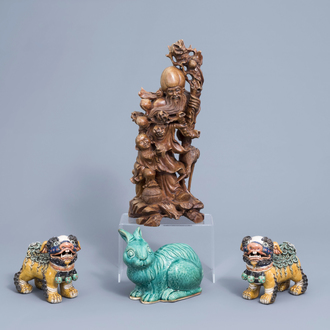 A pair of Chinese polychrome lions, a turquoise model of a rabbit and a wooden group with Shou Lao, 20th C.