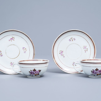 A pair of Chinese famille rose armorial cups and saucers, ca. 1900