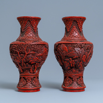 A pair of Chinese cinnabar lacquer vases with figures in a landscape, 19th C.