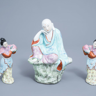A Chinese famille rose figure of Buddha and a pair of ladies with peaches, 20th C.