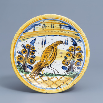 A polychrome Spanish maiolica charger with a bird among flowers, 18th C.
