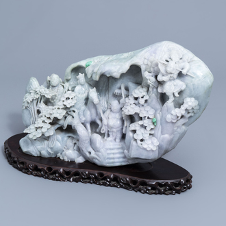 An impressive Chinese jadeite carving with figures in a landscape, 19th/20th C.