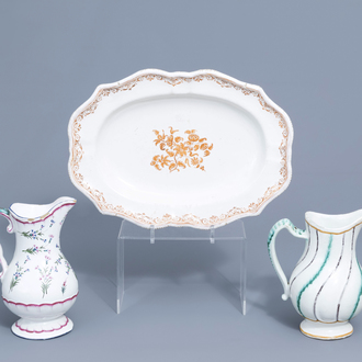 A polychrome French faience oval dish and two pitchers, 18th C.