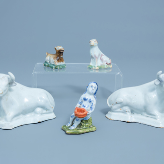 A pair of white Delft models of cows, two polychrome animals and a lady, 18th C.