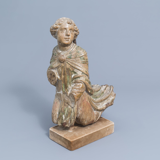 A French carved walnut archangel with traces of polychrome and gilt decoration, 16th C.