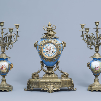 A French Historicism three-piece gilt mounted Sèvres style clock garniture, 19th C.