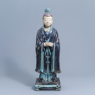 A large Chinese turquoise and aubergine glazed figure of a dignitary, Ming
