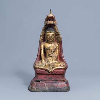 A large gilt, lacquered and polychrome decorated figure of Buddha with inlay, Burma or Laos, 19th/20th C.