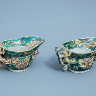 A pair of Chinese verte biscuit libation cups, Kangxi