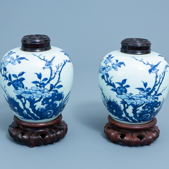 A pair of Chinese blue and white ginger jars with birds among blossoming branches, probably Transitional period
