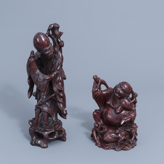 Two Chinese wooden figures of Shou Lao and a laughing Buddha, 19th/20th C.