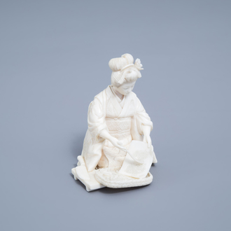 A signed Japanese ivory okimono of a lady at work, Meiji, 19th/20th C.
