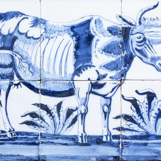 A Dutch Delft blue and white tile mural with a cow, 19th C.