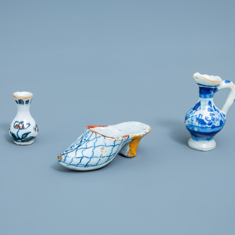 A blue and white doll's house miniature slipper, a jug and a polychrome vase with floral design, Delft and Frankfurt, 18th C.
