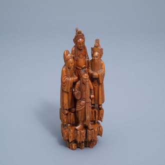 A Chinese carved wooden group with four figures, 19th/20th C.
