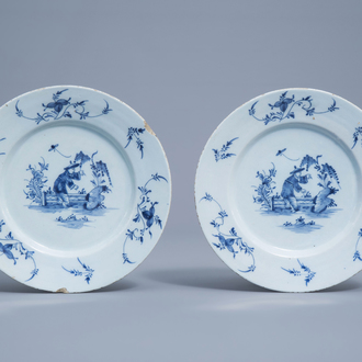 A pair of Dutch Delft blue and white 'chinoiserie' plates, 18th C.