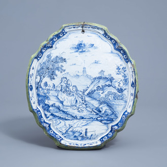 A Dutch Delft blue and white plaque with a galant scene, 18th C.
