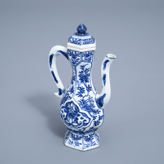 A Chinese blue and white ewer and cover with floral design, Kangxi