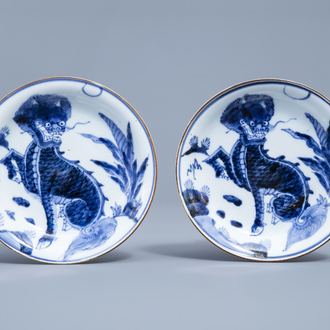 A pair of Japanese blue and white 'komainu' saucer dishes, marked, Edo, 18th C.