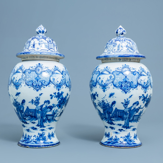A pair of Dutch Delft blue and white 'chinoiserie' vases and covers, 18th C.