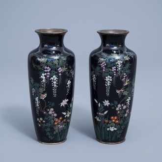 A pair of fine Japanese cloisonné vases with a bird among blossoming branches, Meiji, 19th C.