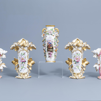 Two pairs of gilt and polychrome old Paris porcelain vases with floral relief design and a 'chinoiserie' vase, 19th C.