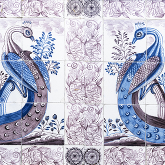 A pair of Dutch Delft blue, white and manganese tile murals with a peacock, 18th C.