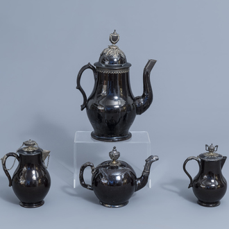 A silver mounted black glazed Namur pottery coffee pot, a teapot and two milk jugs, 18th C.