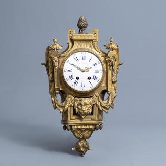 A French Neoclassical gilt bronze cartel clock, 18th C.