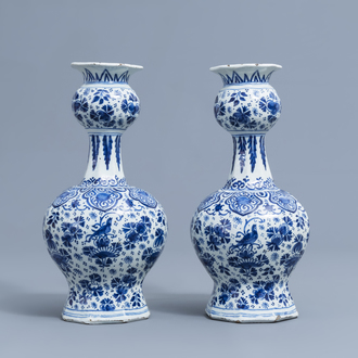 A pair of Dutch Delft blue and white vases with floral design, 18th C.